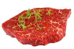 Мраморизованный стейк говядины при изолированный тимиан Стоковая Фотография