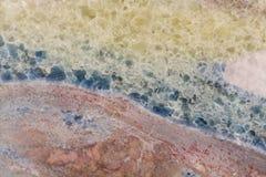 Мраморная каменная предпосылка на макросе Высокое фото разрешения стоковые фото