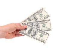 Мужская рука держа американские долларовые банкноты. Стоковое Фото