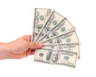 Мужская рука держа американские долларовые банкноты. Стоковая Фотография RF