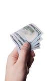 Мужская рука держа 100 банкнот доллара Стоковые Изображения