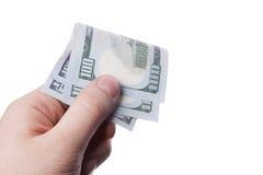Мужская рука держа 100 банкнот доллара Стоковое Фото