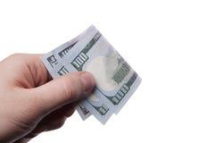 Мужская рука держа 100 банкнот доллара Стоковое Изображение