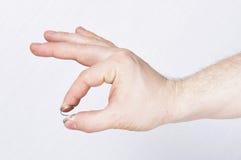 Мужская рука держа весну стоковые изображения