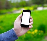 Мужская рука держа телефон с изолированным экраном стоковая фотография rf