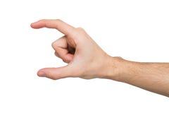 Мужская рука измеряя что-то, вырез, жест стоковые изображения