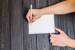 Мужская рука написанная на рамке Стоковая Фотография