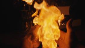 Мужские руки закрыли горящую книгу видеоматериал