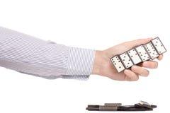 Мужские руки играя домино Стоковое Фото
