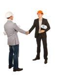 2 мужских молодых инженера тряся руки Стоковые Фото