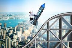 Мужское летание бизнесмена на ракете в концепции дела Стоковое фото RF