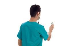 Мужской доктор с стетоскопом от задней стороны изолированной на белой предпосылке Стоковое Изображение RF