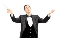 Мужской проводник оркестра сразу с жезлом Стоковое фото RF