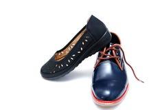 Мужчина моды и женские ботинки Стоковые Изображения