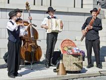 Музыканты оркестра ярмарки Праги Стоковое Фото
