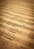 Музыка замечает предпосылку стоковые фото