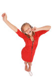 Музыка милого девочка-подростка слушая на ее наушниках Стоковая Фотография RF
