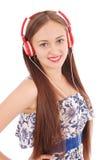 Музыка милого девочка-подростка слушая на ее наушниках Стоковая Фотография