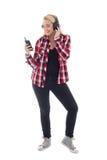 Музыка привлекательного девочка-подростка слушая в headhones изолированных дальше Стоковая Фотография RF
