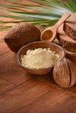 Мука кокоса на таблице Стоковая Фотография
