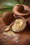 Мука кокоса на таблице Стоковые Изображения