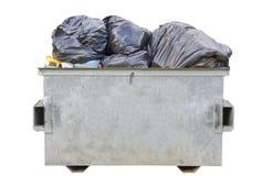 мусорный контейнер вполне над белизной хлама Стоковое Изображение RF