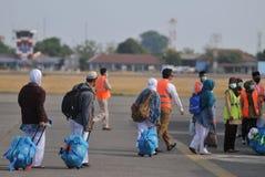 Мусульманские паломники приехали в Индонезию после закончили ежегодное haj Стоковое фото RF