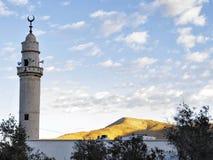 Мусульманский минарет мечети Стоковая Фотография RF