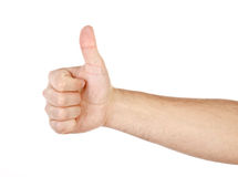 Мыжская рука показывая большие пальцы руки вверх по изолированному знаку Стоковые Фото