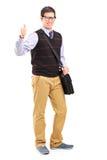 Мыжской студент давая большой пец руки вверх Стоковая Фотография