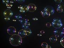 Мыло пузыря над чернотой Стоковая Фотография