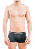 Мышечные сводки боксера молодого человека нося Стоковые Фотографии RF