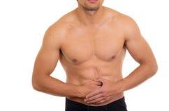 Мышечный без рубашки человек с болью в животе стоковые изображения