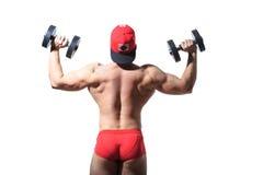 Мышечный парень культуриста делая тренировки при гантели изолированные над белизной вакханические Стоковое Фото