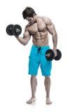 Мышечный парень культуриста делая тренировки с гантелями Стоковая Фотография RF