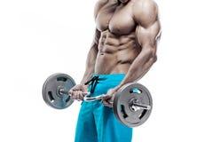 Мышечный парень культуриста делая тренировки с гантелями Стоковое фото RF