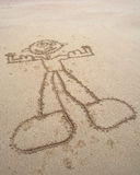 Мышечный человек в песке Стоковое Изображение RF