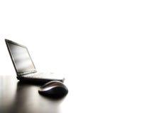 мышь компьтер-книжки светлого тонового изображения Стоковое Изображение