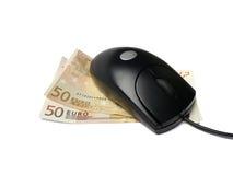 Мышь компьютера на банкнотах евро Стоковое Изображение