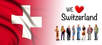 Мы любим Швейцарию, представление группы людей a рядом с швейцарским флагом иллюстрация вектора