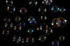 мыло пузырей предпосылки черное Стоковые Фото