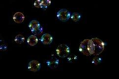 мыло пузырей предпосылки черное Стоковая Фотография RF