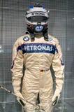 Мюнхен, Германия - 10-ое марта 2016: Костюм Формула-1 водителя гоночной машины BMW нося защитные кожу и шлем Стоковые Фото