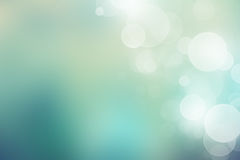 Мягкая зеленая предпосылка с красивыми светами bokeh Стоковые Изображения