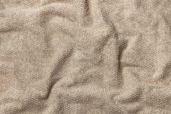 Мягкое полотенце Terry бежевое как предпосылка стоковые изображения