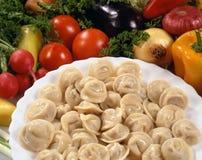 мясо вареников тарелки Стоковые Фото