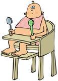 Младенец в высоком стульчике Стоковое Фото