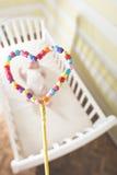 Младенец в кровати в рамке формы сердца Стоковое Изображение RF