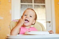 Младенец ест стоковые фото
