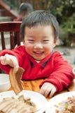 Младенец ребенк ест Стоковое фото RF